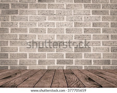 brown tan color brick stone cement wall background texture with aged wood tiles floor perspective:brickwork concrete wallpaper:stucco backdrop interior.showing,advertising,promote products at display - stock photo