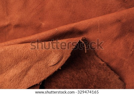 Brown,Tan Leather, Concept and Idea Style of Fine Leather Crafting, Handcrafts, Handmade, Handcrafted, Artisan or Fashion Industry. Background Textured and Wallpaper. Rustic Style. - stock photo