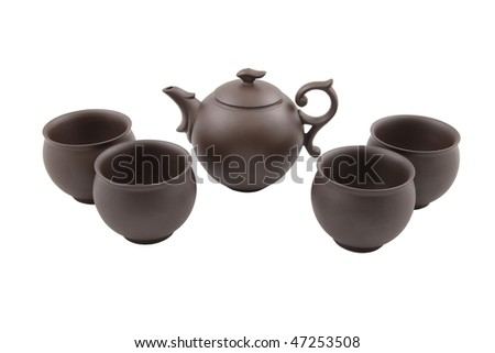 brown teapot with four bowls isolated on white