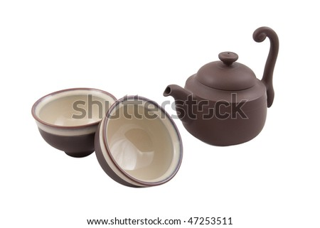brown teapot with two bowls isolated on white - stock photo