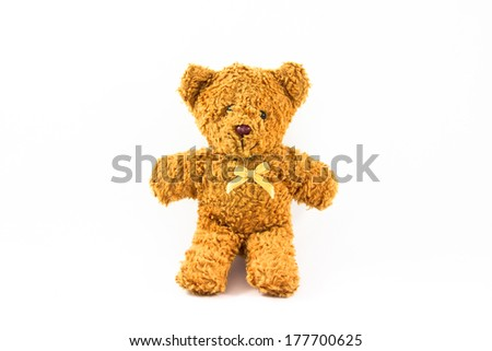 Brown teddy bear seat isolated on white background. Toy for kids. Dolls made from cloth.