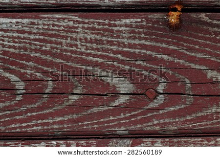 Brown texture of the old wooden plank with a nail - stock photo