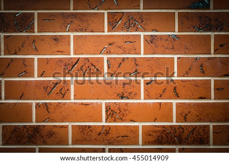 Brown texture tiles under brick background. Wall, vignette. - stock photo