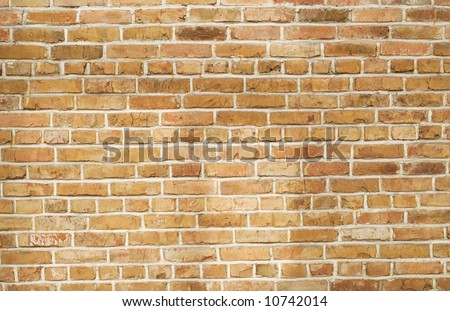 brown textured brick wall background - stock photo