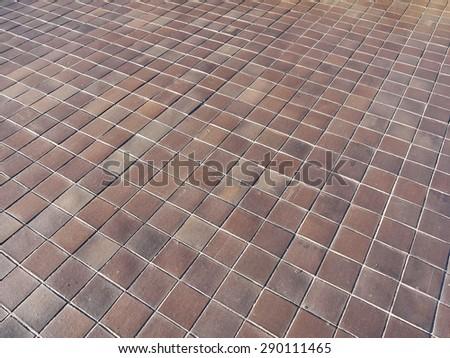 brown tile floor background - stock photo