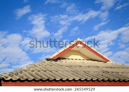 Brown tile roof in garden against blue sky.  - stock photo