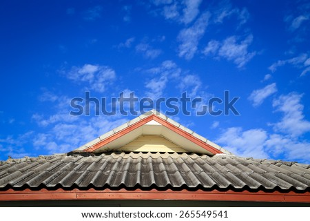 Brown tile roof in garden against blue sky.  - stock photo