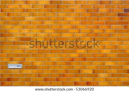 Brown tiled wall with mailbox - stock photo
