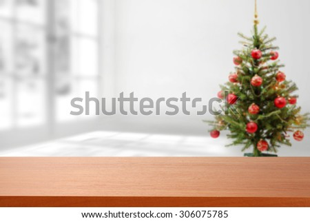 brown top place and xmas tree in white room  - stock photo