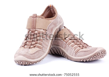 brown trainers on a white background - stock photo