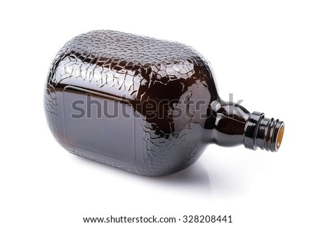 Brown transparent glass bottle, isolated on white.