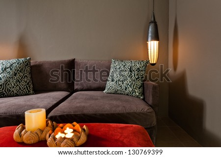 Brown two seated sofa beautiful dark ambience