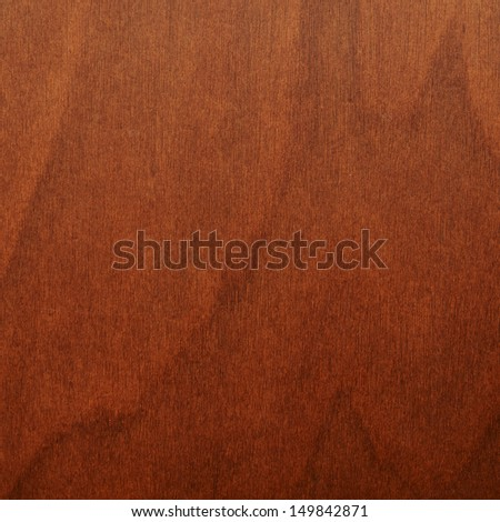 Brown varnished wood fragment as a background - stock photo