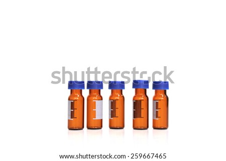 Brown vials with blue caps - stock photo