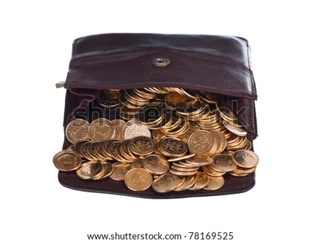 Brown wallet full of golden coins - stock photo