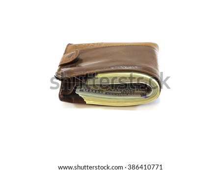 Brown wallet with money on  white background - stock photo