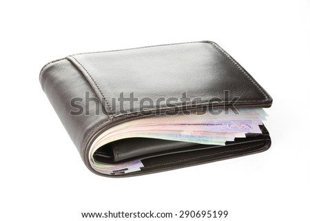 Brown wallet with Thai banknotes on white background (isolated) - stock photo