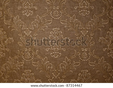 Brown wallpaper background with floral motives - stock photo