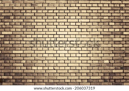 brown weathered brick wall background - stock photo
