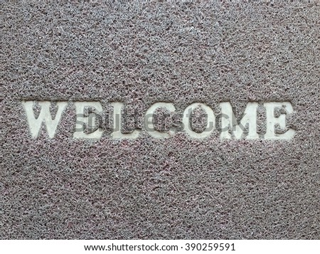 Brown welcome carpet,