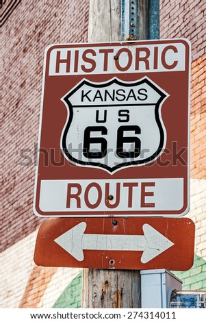 Brown, white, and black sign for historic Route 66 in Kansas