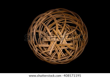 brown wicker basket isolated on black background - stock photo