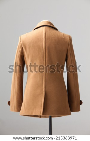 brown winter coat isolated on gray background - stock photo