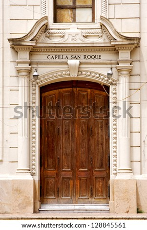 brown wood old door of a church capilla san roque in the centre of buenos aires argentina