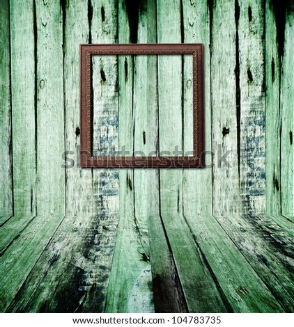 Brown wood picture frame on plank wall with shadow - stock photo
