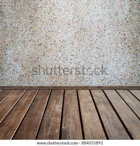 brown wood plank floor with stone wall background - stock photo