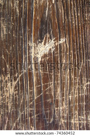 brown wood with some heavy scratch damage - stock photo