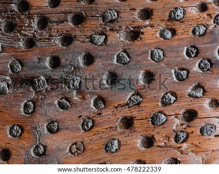 brown wooden background with little black lava stones