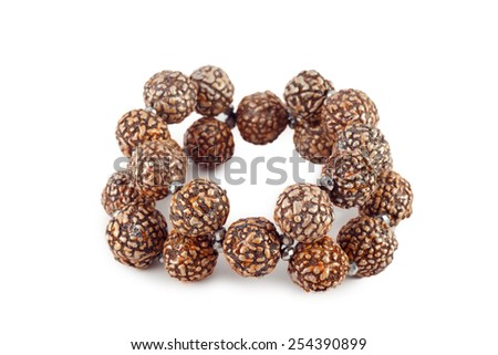 brown wooden beads bracelet isolated on white - stock photo