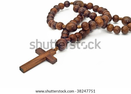 Brown Wooden beads isolated over white with focus on christ (shallow DOF) - stock photo