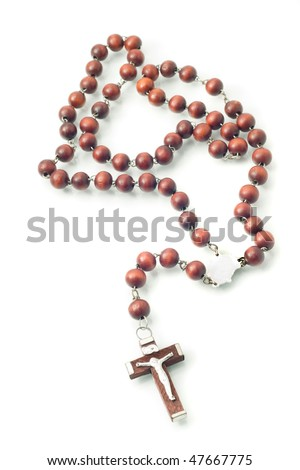 Brown Wooden beads isolated over white with focus on cross (shallow DOF) - stock photo