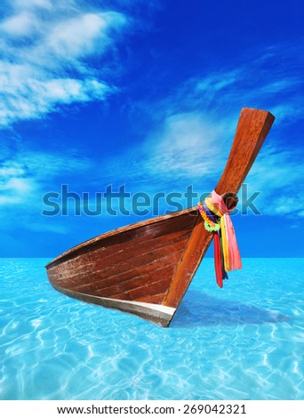 brown wooden boat in the blue sea - stock photo