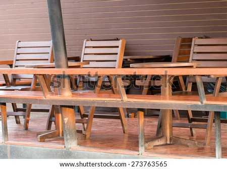 Brown wooden chair near the wooden bar of the coffee shop. - stock photo