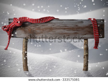 Brown Wooden Christmas Sign On White Snow. Snowy Scenery, Snowflakes. Red Ribbon, Copy Space For Advertisement. Christmas Decoration Or Christmas Card. Rustic Or Vintage Syle. - stock photo