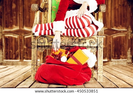 brown wooden interior and xmas time and woman legs on floor