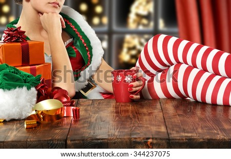 brown wooden table and elf legs  - stock photo