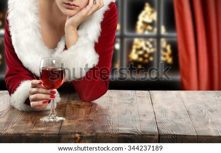 brown wooden table and glass of wine  - stock photo