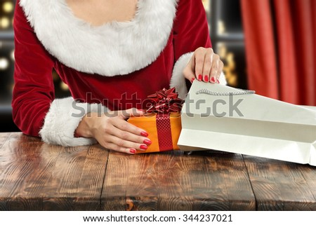 brown wooden table and gray bag of gift  - stock photo