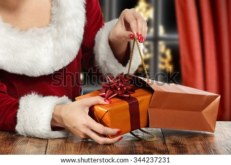 brown wooden table and open bag and gift  - stock photo