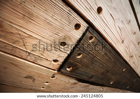 Brown wooden unpainted texture background with knots. Detail. Shallow DOF - stock photo
