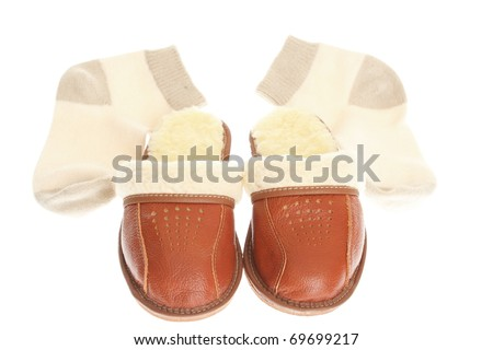 brown wool comfortable slippers and thick woollen socks - house slipper isolated on white background
