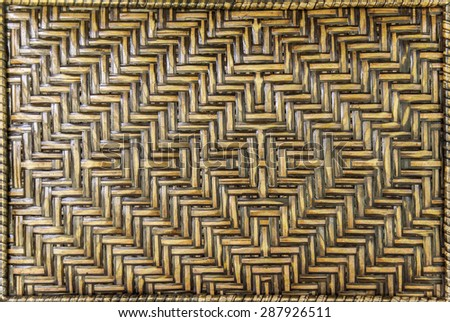 brown woven rattan background, close up  woven rattan bag, products from thailand - stock photo