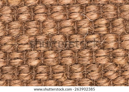 Brown woven synthetic carpet pattern macro for texture or background - stock photo