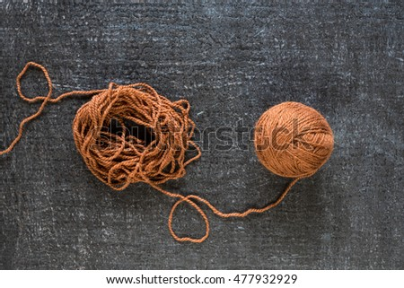 Brown yarn on black grunge background