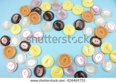 Brown, yellow and Beige Buttons on Blue Background.