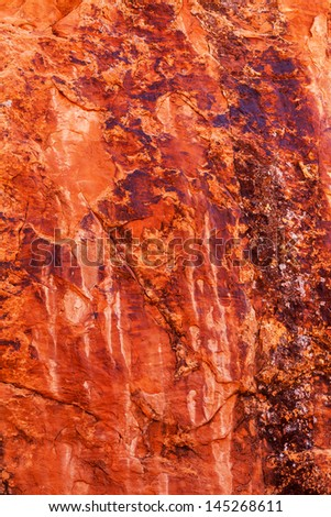 Brown Yellow Orange Rock Canyon Abstract Devils Garden Arches National Park Moab Utah USA Southwest. Lichens on red canyon walls create many abstracts close up.   - stock photo